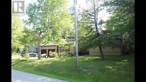 3+1 bedroom home 1 acre lot. LOCATED IN SAWLOG BAY