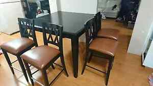 Pub style table and 6 chairs