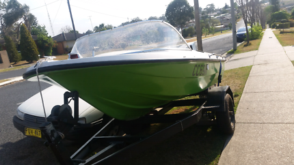 for sale is my 12ft fibreglass boat an traler an motor
