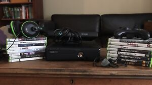 Xbox 360 with games, controllers, and headsets