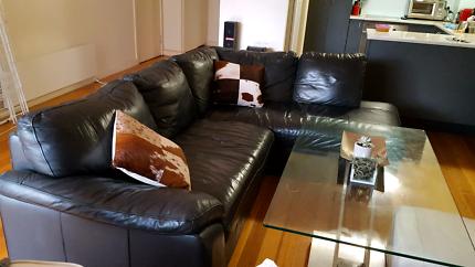 Living room black leather lounge suite sofa