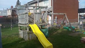 huge playset . Playhouse and swing set