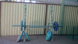 Olympic bar , weights and stand