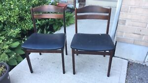 Two solid wood wide leather chairs