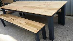 Custom dining table and benches with recycled wood tops