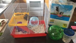 Hamster and cage.