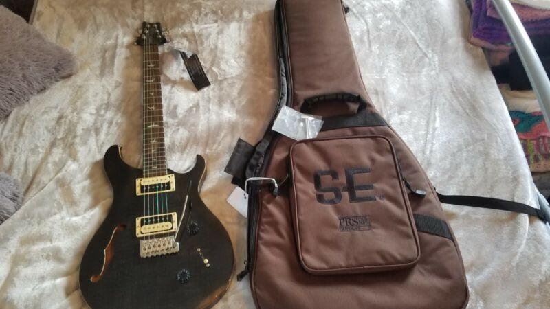 PRS SE Custom 22 Semi Hollow Grey/Black. Open to reasonable offers.
