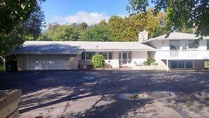 Beautiful custom built 4 level split home on 1 acre $579,900.00