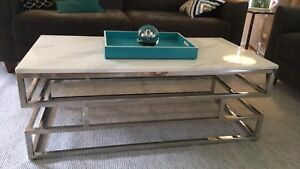 Modern coffee table with faux marble top.