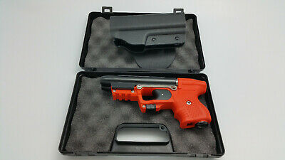 FIRESTORM JPX 2 LE PEPPER ORANGE GUN WITH LASER AND PADDLE HOLSTER