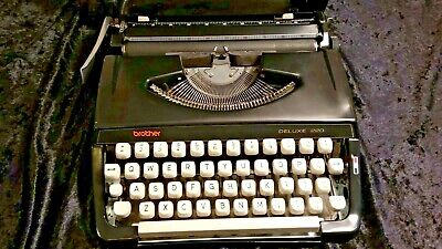 Brother Typewriter 220 Deluxe. - 1970s portable machine with integral carry case