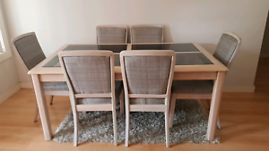 Teak wood dining table and 6 chairs