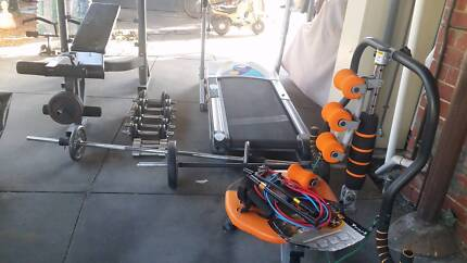 Gym equipment, Treadmill , Weights, lift bench and punch bag