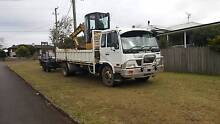 Nissan UD truck, 5t cat excavator and plant trailer combo Darling Heights Toowoomba City Preview