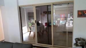sliding glass door with crimsafe security screen