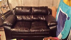 Black Leather love seat/excellent new condition $300