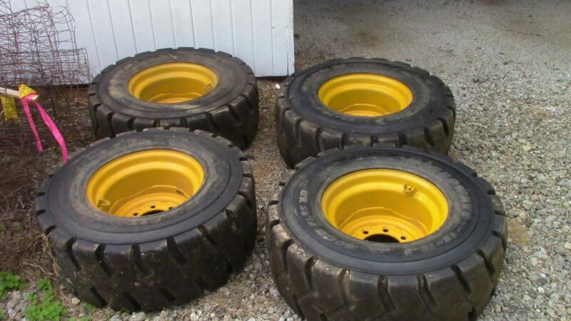 Skid steer tires and rims 12 X 16.5