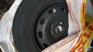 Michelin X ice xi3 - size 195/65/15- 4 winter tires  with 4 Rims