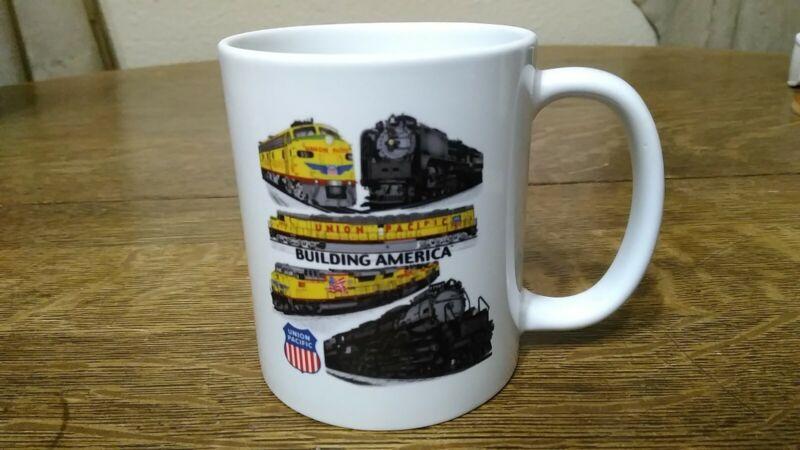 UNION PACIFIC BUILDING AMERICA COFFEE MUG - 5 TRAINS ON THE MUG & EMBLEM GREAT S