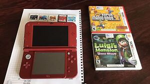Nintendo 3DS XL with 8 games