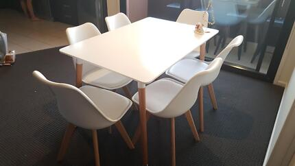 White dinner table with x6 egg cushion chairs
