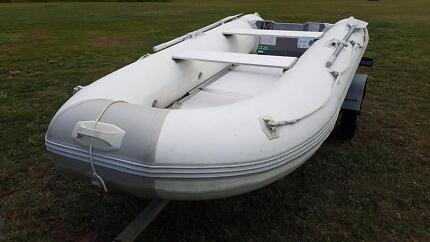 Inflatable boat, outboard motor and trailer for sale