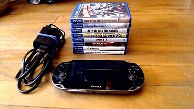 SONY Playstation Vita PS VITA portable system with 8 games and 32 gb memory card