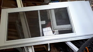 Storm door 34 inches wide x 80 tall new never used .