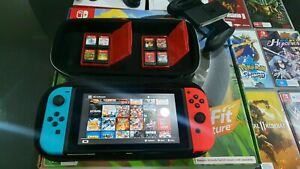 New Model Nintendo Switch - 15 Games - Pro Cntrlr & Ring Fit Adventure