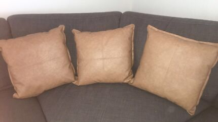 3 faux leather cushions