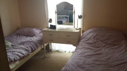 Two single beds and dressing table