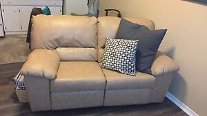 2 year old leather electric reclining loveseat