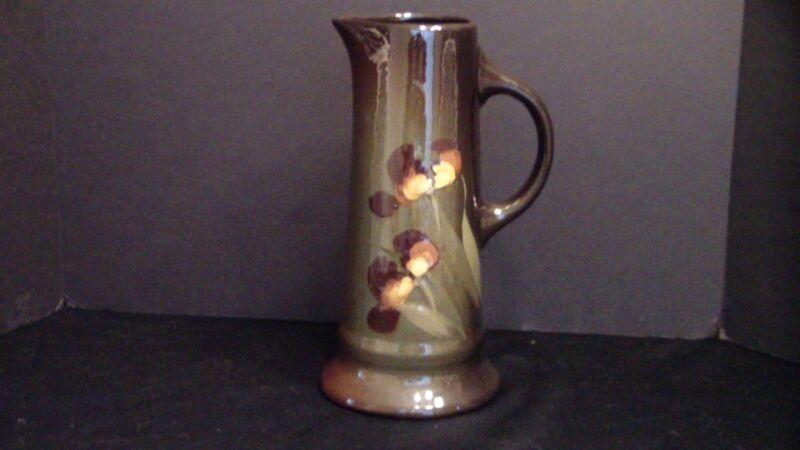 A Tall Brown Pottery Tankard