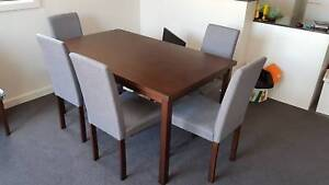 Dining Table with 6 Chairs in a good condition