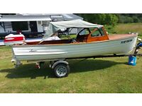 Vintage 1957 Lyman 15 foot wooden boat with original motor and trailer