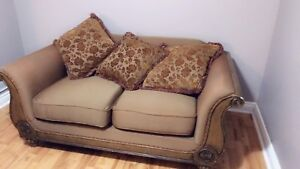 Antique loveseat with pillows