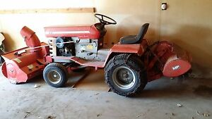 Riding Tractor with Snowblower and Rototiller