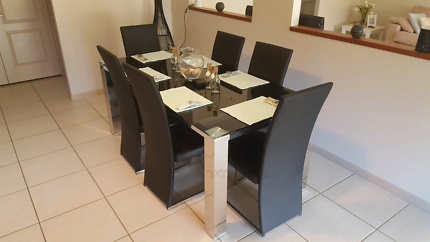 Glass,metal and leather dining table