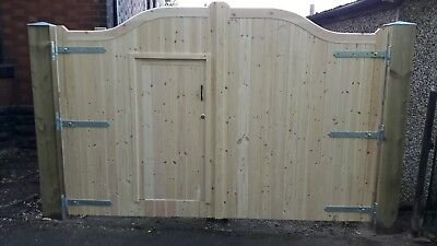 Swanneck wooden driveway gates with trade (personal )door 6'o