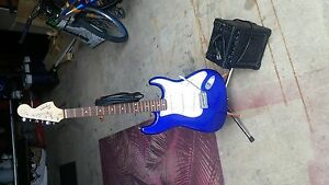 Squier strat electric guitar with amp.