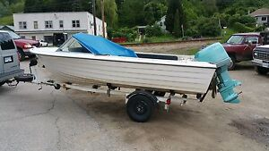 Evinrude 150 horse on Glastron 16.5 with road runner trailer