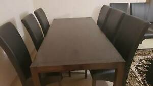 Dinning table 8 seater good condition leather chairs