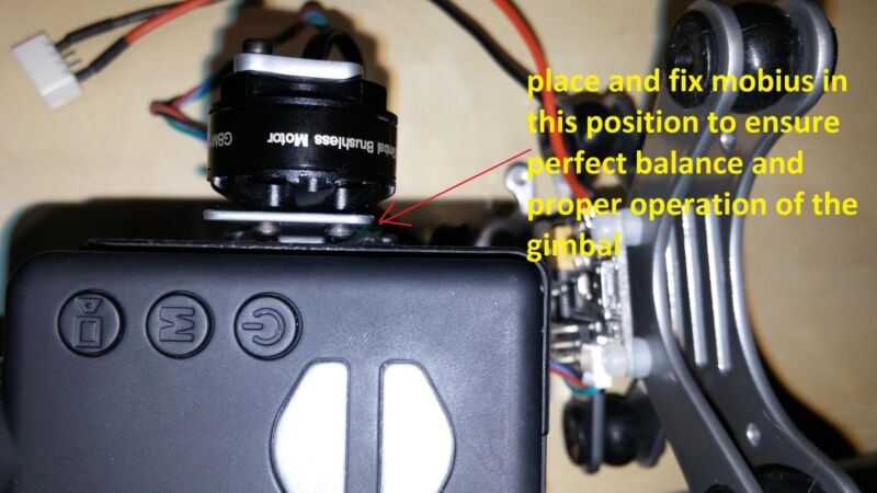 Fig. 11 - Place one washer under the holder plate and an other washer at the top when attaching the camera.