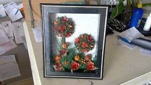 Shadow box, with apple  and orange trees and foliage.