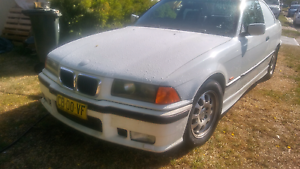 """Bmw. Original wheels good tyres 4x15"""" or 2x17"""" St Helens Park Campbelltown Area Preview"""
