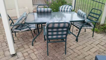 Glass outdoor table and 6 chairs