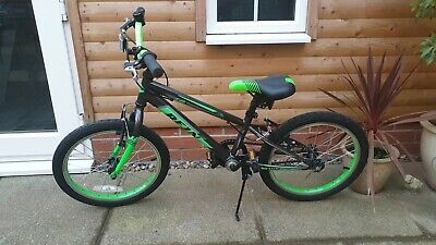 Childrens green and black bike 18 inch (Boys). Very good Condition