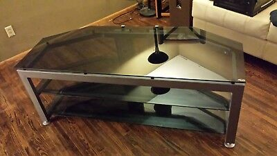 - BUSH INDUSTRIES ENTERTAINMENT CENTER, TEMPERED SMOKED GLASS & STEEL