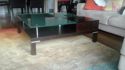 Wooden coffee table with frosted glass top & storage drawer.