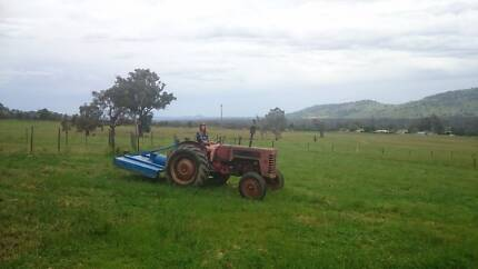 Tractor and slasher for sale runs well for an old girl